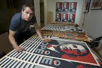 Los Angeles street artist Shepard Fairey signs his Barack Obama Hope artwork in the Echo Park area of Los Angeles. He is the designer of the famous Obama campaign poster and also the Obey-Andre the Giant poster of a few years back.(Damian Dovarganes/The Associated Press)