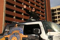 Dallas County Sheriff Lupe Valdez waved to the crowd during the Dallas Holiday Parade through downtown Dallas on Saturday. (Andy Jacobsohn/Staff Photographer)