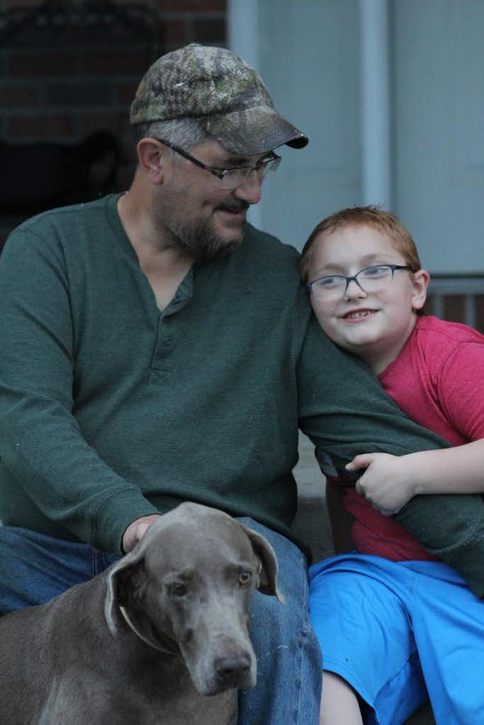 Bryan Latkanich, with his 7-year-old son, Ryan.(Anna Belle Peevey/InsideClimate News)
