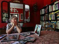 Jane Pena looks at photos of her son, George Cornell, shortly after his death in Parkland Memorial Hospital's psychiatric ward.(Staff/2011 File Photo)
