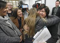 Lupe Valdez is hugged by well-wishers after her announcement at a news conference Wednesday in Austin that she will seek the Democratic nomination for Texas governor.(Louis DeLuca/Staff Photographer)