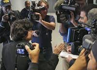 Lupe Valdez makes her way through the media to head to the airport after her announcement that she will seek the Democratic nomination for Texas governor.(Louis DeLuca/Staff Photographer)