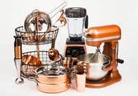 Copper kitchen wares including a two-tiered basket, KitchenAid mixer, Vitamix blender, Cuisinart blender and more.(Ashley Landis/Staff Photographer)