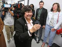 Recently-resigned Dallas County Sheriff Lupe Valdez makes her way through the media to head to the airport after her announcement that she will seek the Democratic nomination for Texas Governor at a news conference in Austin on Wednesday.(Louis DeLuca/Staff Photographer)