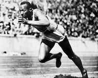 "Jesse Owens competed in one of the heats of the 200-meter run at the 1936 Olympic Games in Berlin on Aug 14, 1936. Owens was a favorite subject of ""Olympia"" filmmaker Leni Riefenstahl.(Uncredited/AP)"