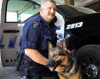 Dallas police Senior Cpl. Craig Woods with his police dog  El. (2013 File Photo/Louis DeLuca)