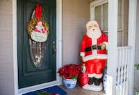 A large Santa figure is part of a collection of vintage Christmas ornaments and decorations at Caroline Nelson's home.(Ashley Landis/Staff Photographer)