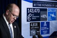 WASHINGTON, DC - DECEMBER 5: End of year statistics are displayed on a monitor as Thomas Homan, Senior Official Performing the Duties of the Director of Immigration and Customs Enforcement (ICE), speaks during a Department of Homeland Security press conference to announce end-of-year numbers regarding immigration enforcement, border security and national security, December 5, 2017 in Washington, DC. (Photo by Drew Angerer/Getty Images)(Drew Angerer/Getty Images)