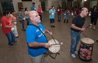 Trinidad Cruz (center) plays a drum while others practice a traditional <i>matachines </i>dance at St. Rita Catholic Community in preparation for the costumed performance that weekend.(Rex C. Curry/Special Contributor)