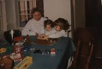 Nancy McCall (left), Nanette Light's grandmother, watches as Light (right), age 3, cuts out gingerbread cookies with her younger sister, Caroline Light Buescher, in December 1990. (Provided by Nanette Light)