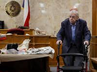 Former priest John Feit walks past clothing worn by Irene Garza in the 92nd state District Court for the fourth day of his trial on Dec.  5, 2017, at the Hidalgo County Courthouse in Edinburg.(Nathan Lambrecht/The Monitor)