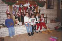 Nanette Light (second from left), then age 7, sits with her sisters and cousins (from left to right) Trey McCall, Kelcie Brown, Caroline Light Buescher and Rebecca Light on the fireplace at her grandmother Nancy McCall's house in Norman, Okla., in 1994. (Provided by Nanette Light)
