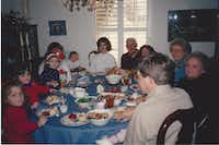 Nanette Light (front left), then age 6, sits around the dining room table in 1993 with her family, including her grandmother Nancy McCall (second from right) at McCall's home in Norman, Okla. (Provided by Nanette Light)