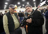 Gun owners discussed a potential sale of an AR-15 during the 2013 Rocky Mountain Gun Show at the South Towne Expo Center in Sandy, Utah. (File Photo/The Associated Press )