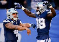 Dallas Cowboys quarterback Dak Prescott and wide receiver Dez Bryant celebrate running back Rod Smith's fourth-quarter touchdown catch-and-run against the New York Giants Sunday at MetLife Stadium in East Rutherford, N.J.(Tom Fox/Staff Photographer)