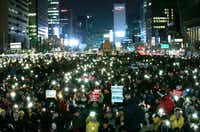 Protesters held up their smartphone lights during a rally calling for impeached President Park Geun-hye's arrest in Seoul, South Korea, in March.(Ahn Young-joon/The Associated Press)