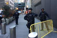 Police block off a sidewalk while responding to a report of an explosion near Times Square on Monday in New York.(Mark Lennihan/AP)