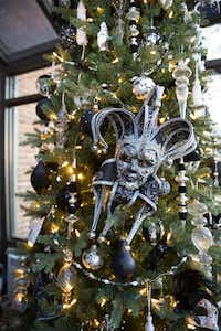 A mask the couple bought during a trip to Disney World inspired the black-and-white tree in the sunroom of the historic home they've been restoring for the last year.(Allison Slomowitz/Special Contributor)