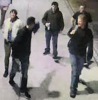 The Southern Methodist University Police Department is looking for a group of people considered persons of interest in the case of white supremacist banners and fliers that appeared on campus in the first weekend of December. These five people were seen in surveillance footage at Park Cities Plaza about 11:20 p.m. Dec. 2.(SMU Police Department)