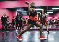 Brent BreShon (center) and other students participate in a Twerkout with Cam class, led by Camille Thompson (right) at Power House School of Dance in Dallas. The class combines twerking with a workout.(Ashley Landis/Staff Photographer)