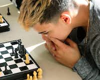 Abdiel Flores Resto studies his next move during a chess match at Duncanville High School. School district bus driver Donald Harris plays chess with students during their lunch periods.(David Woo/Staff Photographer)