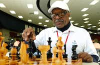 Donald Harris plays chess with Duncanville High School student Pablo Ramirez during lunch in the school's cafeteria. Harris sets up chess boards and plays as many students as he can when he visits the school.(David Woo/Staff Photographer)