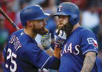 Rangers Mike Napoli (right) and teammate Jonathan Lucroy pull each other's beards after Napoli's third-inning home run against the Miami Marlins in Arlington.(Tom  Fox/Staff Photographer)