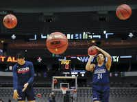 Connecticut Huskies guard/forward Napheesa Collier (right) and teammate Gabby Williams shoot baskets during practice for their NCAA Women's Final Four semifinal game at American Airlines Center in Dallas.(Tom Fox/Staff Photographer)