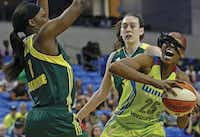Dallas Wings forward Glory Johnson (right) tries to get around Seattle Storm forward Crystal Langhorne during a WNBA game at College Park Center in Arlington.(Jae S. Lee/Staff Photographer)