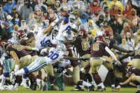 Dallas Cowboys defensive end Tyrone Crawford, with bandage on arm, blocks a field goal attempt by Washington Redskins kicker Nick Rose (6) during the second quarter at FedEx Field on Oct. 29.(Jae S. Lee/Staff Photographer)