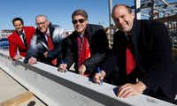 From left: John Harkes, member of the 2005 National Soccer Hall of Fame class; U.S. Soccer Federation secretary general/CEO Dan Flynn; FC Dallas chairman Clark Hunt; and FC Dallas president Dan Hunt pose before signing their names on the final structural beam that will be part of the Hall of Fame Club at Toyota Stadium. (David Woo/Staff Photographer)