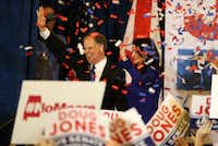 Sen.-elect Doug Jones and his wife, Louise Jones, greet supporters during his election night gathering Tuesday at the Sheraton Hotel in Birmingham, Ala. Jones, a Democrat, defeated Roy Moore, the Republican candidate dogged by sexual misconduct accusations, to claim the U.S. Senate seat vacated when Jeff Sessions became attorney general. (Justin Sullivan/Getty Images)