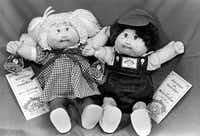 How hot were Cabbage Patch Kids in December 1983? These two were part of a holiday shopping window display at the Beverly Hills Cartier store that year.(The Associated Press/1983 File Photo)