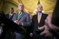 Senate Majority Leader Mitch McConnell, R-Ky., and Sen. John Cornyn, R-Texas, speak to reporters about the Alabama Senate race.(Al Drago/Getty Images)