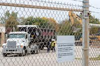 Workers prepare a truck to remove debris from the former Texas Air National Guard armory as it is demolished Nov. 7 at Central Park in Garland.  The former armory was razed to make room for a new dog and skate park.(Jeffrey McWhorter/Special Contributor)