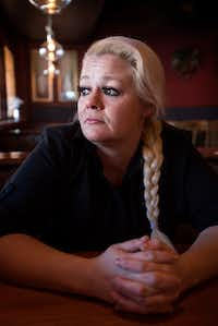 Christal Scott, a 42-year-old single mother and waitress, poses for a portrait on Dec. 13, 2017, at Kay's Restaurant and Bar in Dallas, where she works.  After getting into a dispute over payments and having her car repossessed by 1and2 Automotive, Scott took the used-car dealer to small claims court.(Jeffrey McWhorter/Special Contributor)