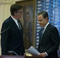 Lt. Gov. Dan Patrick, left, and Speaker Joe Straus confer before Gov. Greg Abbott's state of the state speech in January.