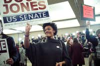 Supporters of Doug Jones, the Democratic candidate for U.S. Senate, celebrate his victory at an Election Night gathering in Birmingham, Ala., on Dec. 12, 2017. African-American voters played a crucial role in Jones' stunning upset win over Republican candidate Roy Moore.(Bob Miller/New York Times)