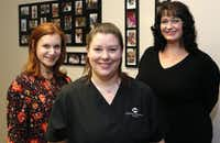 Ashley Moore (center), of Rockwall, (center), a surrogate who is currently pregnant for a couple; Jill Errera (left), of Dallas, who has been a surrogate four times; and Stephanie Scott, co-owner of Simple Surrogacy, who has also has been a surrogate.(David Woo/Staff Photographer)