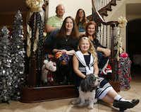Robert and Kirsten Smith (middle row left) pose with Jill Errera (middle row right), who carried their daughter Merrin (front), 7, as a surrogate mom. The Smiths' older daughter Maya Smith, 12, is at back right.(Nathan Hunsinger/Staff Photographer)