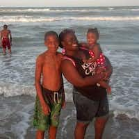 Jordan Edwards (left) with his stepmother, Charmaine Edwards, and his sister Korrie on a family trip to the beach.(Edwards Family)