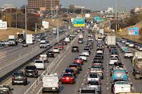 <p>The 10.8 miles of Interstate 635 in Dallas, Garland and Mesquite was to have included both free and managed lanes, with tolls on the managed lanes used to pay back the project's debt. But Gov. Greg Abbott and Lt. Gov. Dan Patrick told commissioners last month that toll roads were no longer an option.<br></p>(David Woo/Staff Photographer)