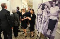 Attendees walk past a photo of Ruth Altshuler, at right in the black-and-white photograph, that was on display at a reception after the memorial service for philanthropic and civic icon Ruth Altshuler of Dallas, held at the Umphrey Lee Center at SMU in Dallas on Thursday, December 14, 2017. (Louis DeLuca/Staff Photographer)