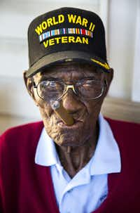 <p>Richard Overton, 111, the oldest living U.S. war veteran, smokes a cigar on his front porch in Austin. Overton is known for puffing on a cigar and drinking whiskey while spending hours on his porch on nice days.<br></p><p>Ashley Landis</p>(Staff Photographer/<p><br><br></p>)