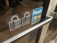 A sample of window decals given to Mesquite residents and businesses as a reminder to take, lock and hide.(Wayne Larson/City of Mesquite)