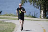 James Snell enjoys a run at White Rock Lake. He starts every morning asking himself what he can do to be a better person.(2014 File Photo/Staff )