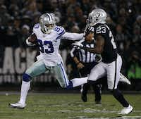 Dallas Cowboys wide receiver Terrance Williams tries to elude Oakland Raiders cornerback Dexter McDonald in the first quarter Sunday night in Oakland. (Rose Baca/Staff Photographer)