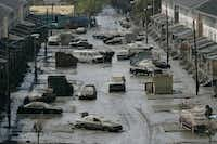 Cars are strewn in the mud in New Orleans' Lower Ninth Ward on Sept. 15, 2005.(Cheryl Diaz Meyer/File Photo)
