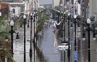"<p><span style=""font-size: 1em; background-color: transparent;"">Canal Street is flooded one day after Hurricane Katrina struck New Orleans in 2005.</span></p>(Chris Graythen/AFP/Getty Images)"