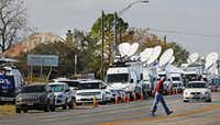 Satellite trucks line Highway 87 in Sutherland Springs on Nov. 7.(Louis DeLuca/Staff Photographer)